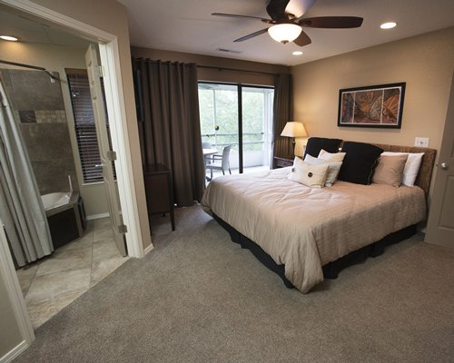 A well furnished bedroom with balcony.