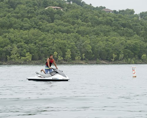 A man riding a jet ski in the lake.
