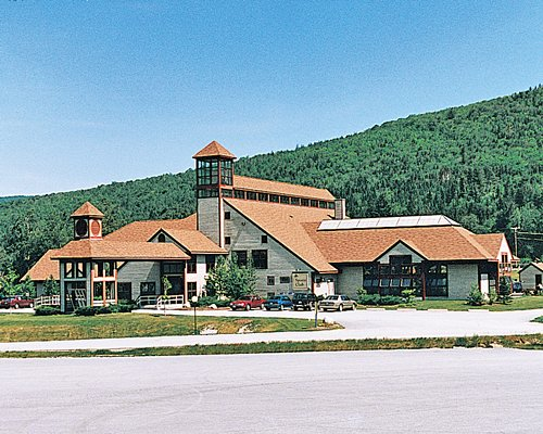 An exterior view of Bretton Woods resort surrounded by wooded area.