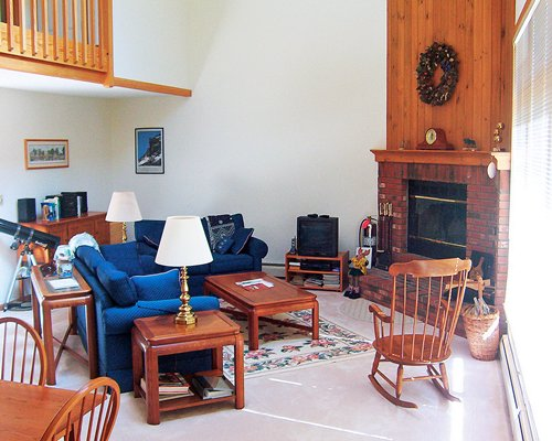 A well furnished living room with fireplace.