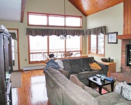 A well furnished living room with a dining area television fireplace and balcony.
