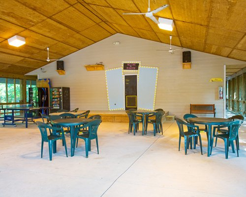 A large indoor recreational area with an outside view.