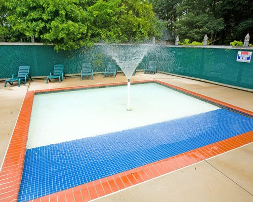 A water sprinkling in the outdoor swimming pool.