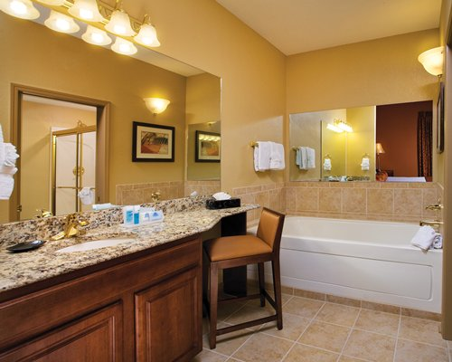 A bathroom with double sink vanity and a bathtub.