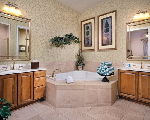 A bathroom with a bathtub and dressing table.