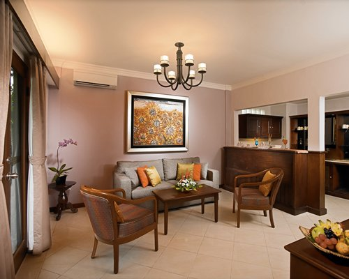 An open plan living room with double pull out sofa and kitchen area.