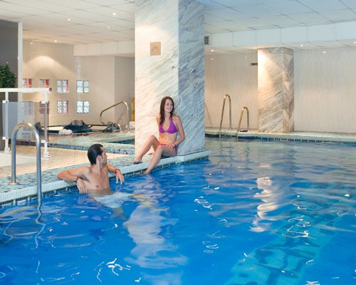 A couple in the indoor swimming pool.