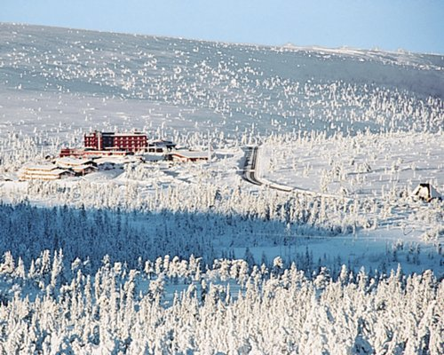 An exterior view of Hogfjallet resort covered in snow.