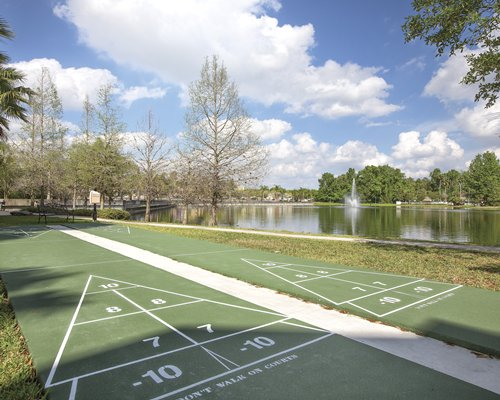 Scenic outdoor shuffleboards and golf course alongside the waterfront.