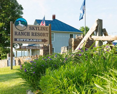 Signboard of Skyline Ranch Resort alongside resort units.