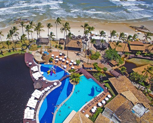 The Cana Brava Resort Hotel with outdoor swimming pool alongside the beach.