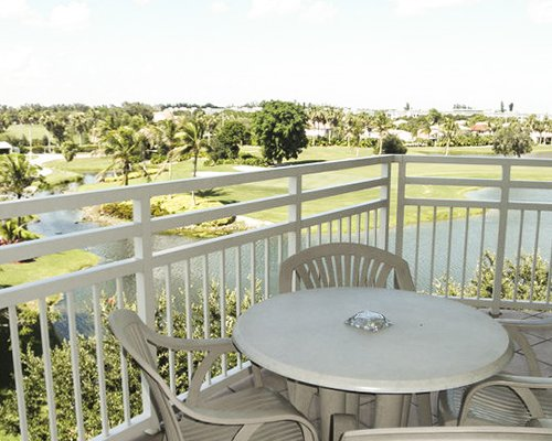 Balcony view with patio furniture .