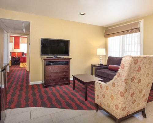 A well furnished living room with dining area and open plan kitchen.