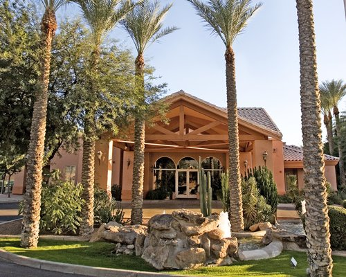Scenic exterior view of Scottsdale Villa Mirage resort with palm trees.