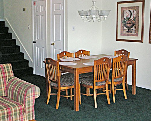 A well furnished dining alongside the staircase.