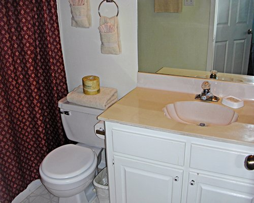 A bathroom with single sink vanity.