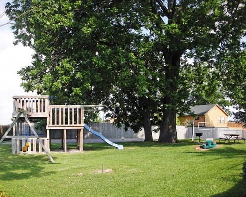 An outdoor recreation area with kids playscape.