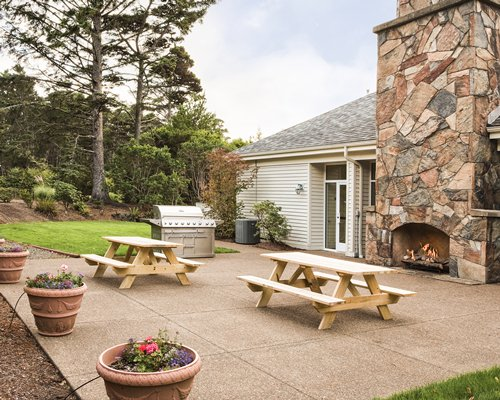 An outdoor recreational area with picnic table and barbecue grill.