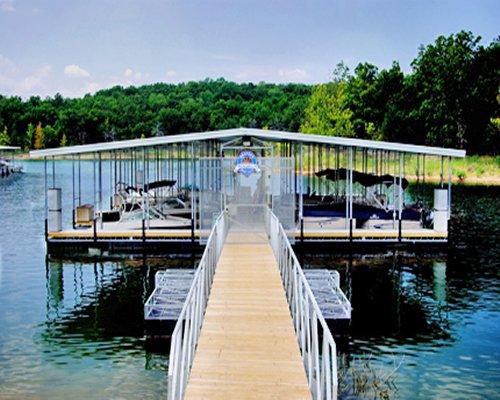 A wooden pier leading to a marina in the lake.