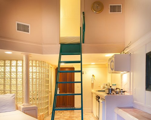 A view of an indoor ladder alongside a kitchen.