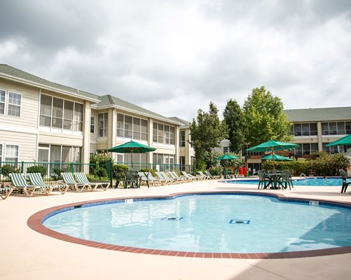 An indoor swimming pool with a patio.