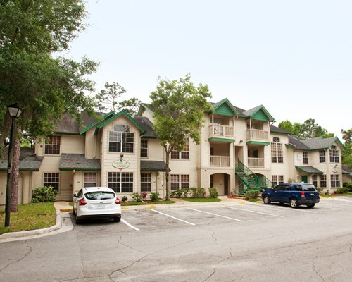 Scenic exterior view of Oak Plantation a SunVest Resort with parking lot.