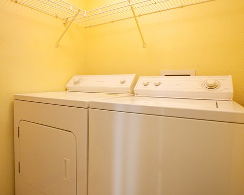 An indoor laundry room with two washing machines.