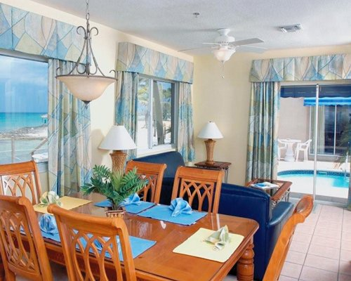 A well furnished dining area with an ocean view.