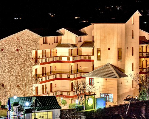 An exterior view of the Sterling Manali resort at night.