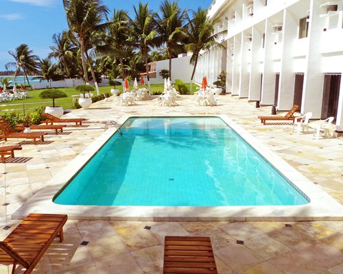 Outdoor swimming pool alongside the beach.