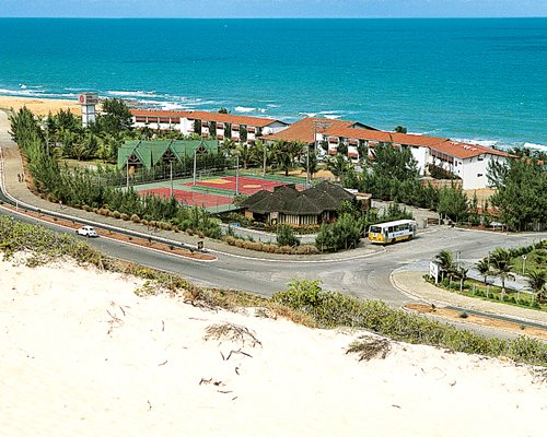 An aerial view of the resort property alongside the ocean.