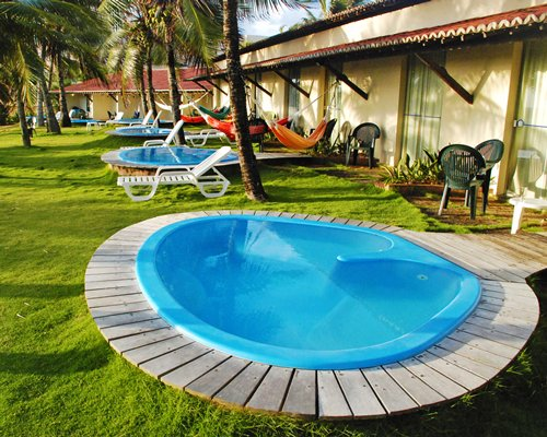 Scenic outdoor hot tubs alongside patio furniture hammock and the resort.