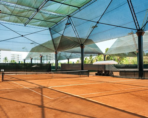Covered outdoor recreation area with tennis court.