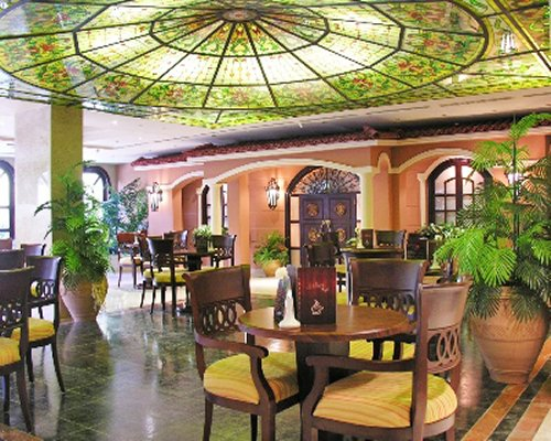 An indoor restaurant with potted plants.