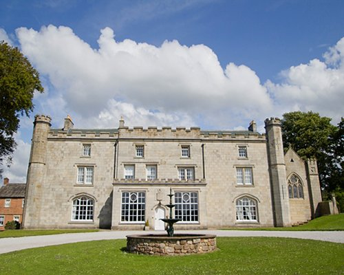 Exterior view of Thurnham Hall with a fountain.