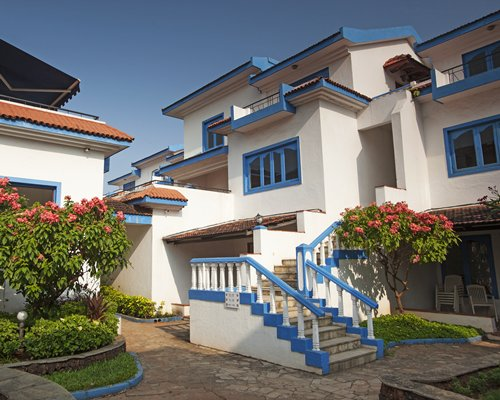 Scenic exterior view of a unit with stairway and balcony.