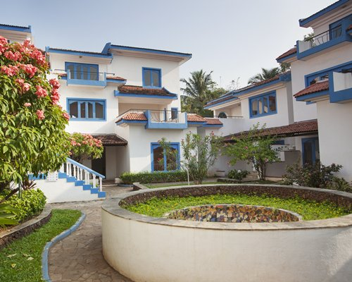 Exterior view of multiple units at Karma Royal Haathi Mahal with a stairway.