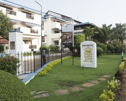 Exterior view of Karma Royal Haathi Mahal with a signboard.