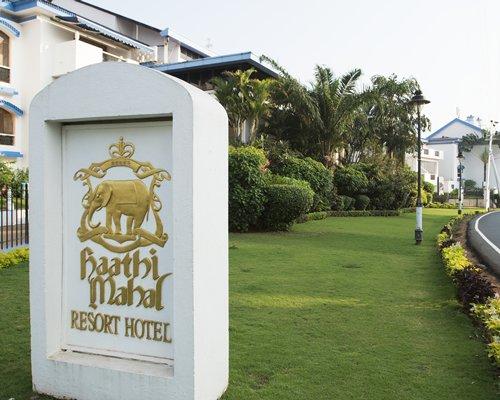 Signboard of Karma Royal Haathi Mahal resort alongside multi story resort units.
