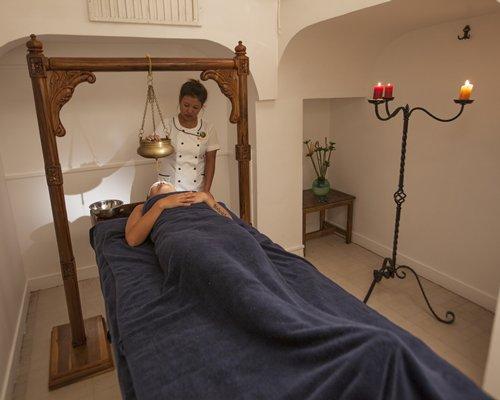 A woman enjoying a massage in an indoor spa.