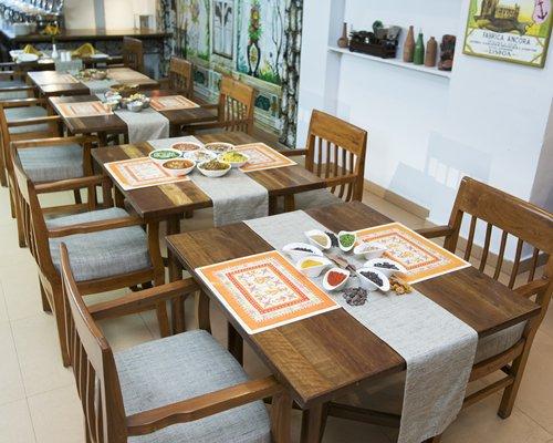 A well furnished indoor restaurant at Karma Royal Haathi Mahal.