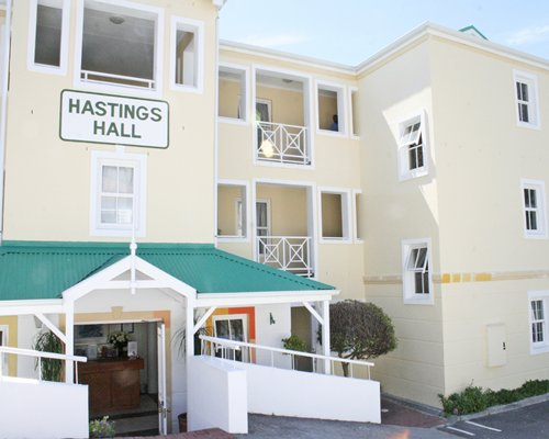 Exterior view of Hastings Hall with multiple balconies.