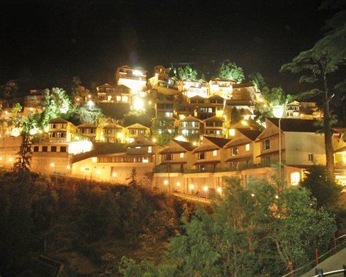 Scenic exterior view of the Avalon Mussoorie at night.
