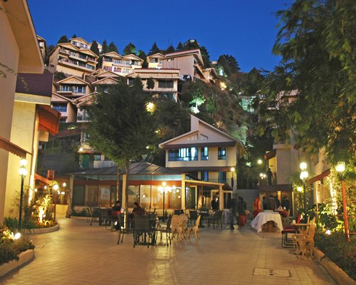 Exterior view of Avalon Mussoorie resort at night.