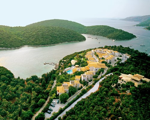 An aerial view of Agios Nikolaos Bay resort alongside the ocean.
