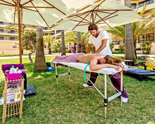 A woman having a massage at outdoor spa.