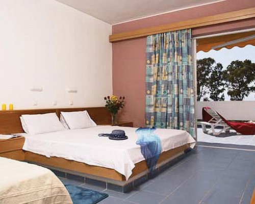 A well furnished bedroom with a twin bed and balcony.