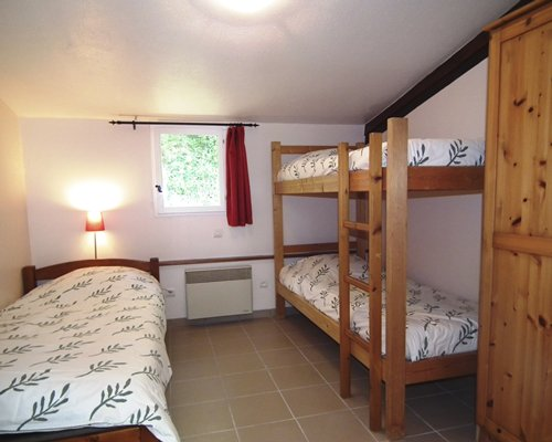 Furnished bedroom with two twin bunk beds.