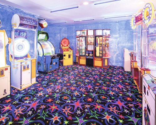 An indoor recreational room with arcade games.