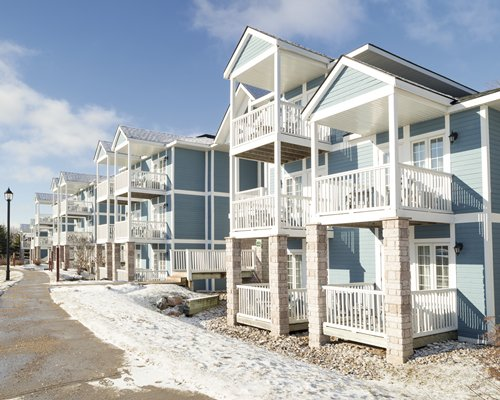 Exterior view of multiple unit balconies at Carriage Hills Resort during winter.